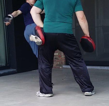 Leg kick for MMA using thai pad